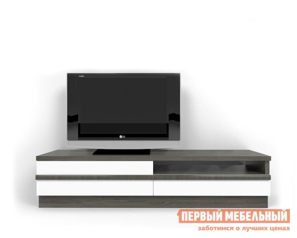 ТВ-тумба Мирлачев Линдау тумба Туя темная / Белый крап Мирлачев Габаритные размеры ВхШхГ 458x2002x450 мм. Большая тумба для телевизора и мультимедиа системы.  Лаконичный дизайн модели с нотками стиля модерн привлечет внимание любителей минимализма в интерьере. <br>Массивная столешница с шириной 2002 мм позволяет установить телевизор любой диагонали.  В основании располагаются выдвижные ящики и ниша для аппаратуры с размерами (ВхШ): 120 х 960 мм. <br>Тумба изготавливается из ЛДСП толщиной 16 и 40 мм, фасады — МДФ.  Края обработаны кромкой ПВХ.  В ящиках используется система открытия «push-to-open». <br>